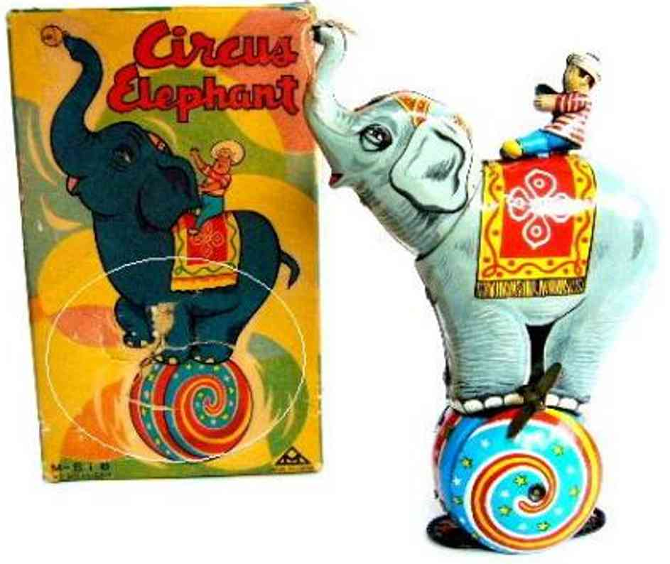 mitsuhashi tin toy circus elephant with rider balancing on spinning ball with f