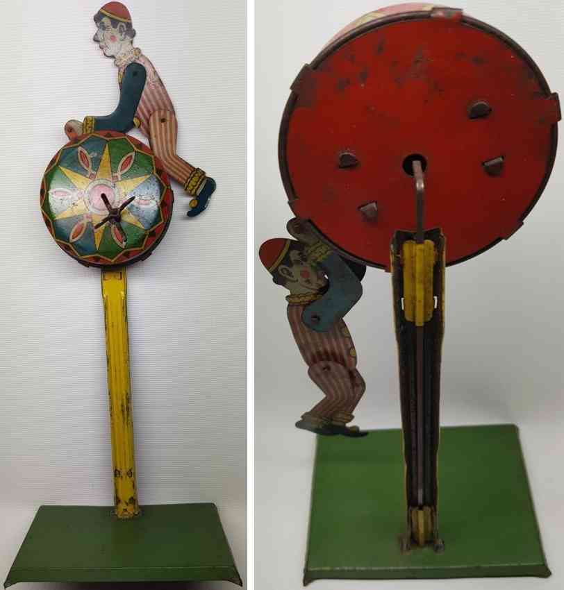 moskowitz max nuernberg tin toy clown on colorful wheel with clockwork