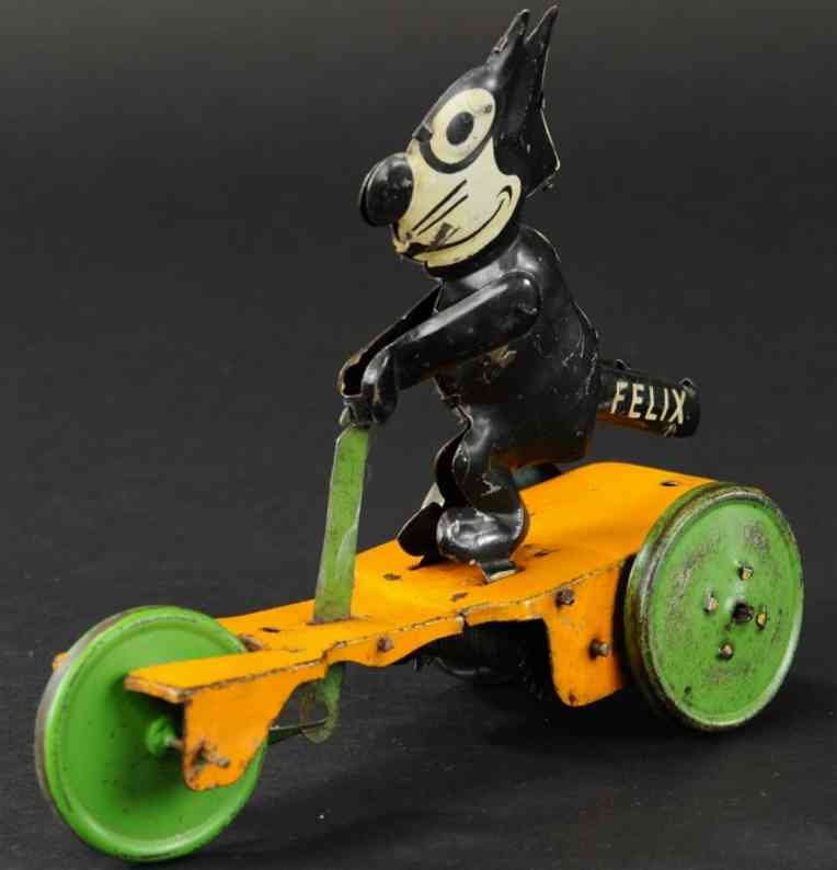 nifty manufacturing company tin toy felix on scoote