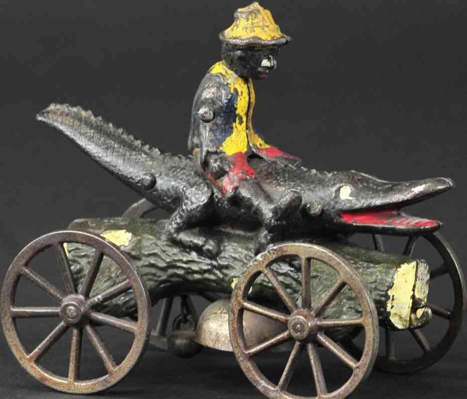 n.n. hill brass co gusseisen junge auf krokodil als glockenspielzeug