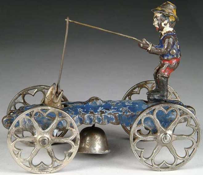 n.n. hill brass co cast iron boy fishing bell toy