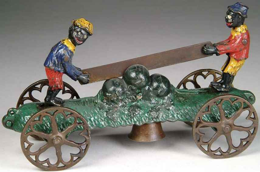 n.n. hill brass co cast iron toy two darkies sawing watermelones bell toy