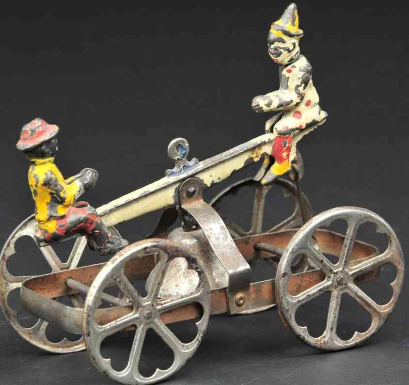 n.n. hill brass co  gusseisen wippe als glockenspielzeug clown schwarzer
