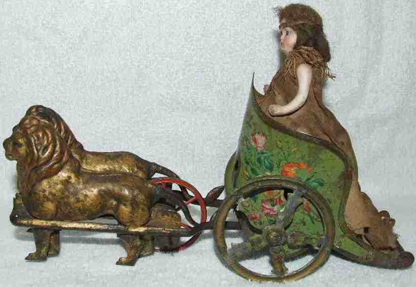pm tin toy mechanical lion chariot with doll windup