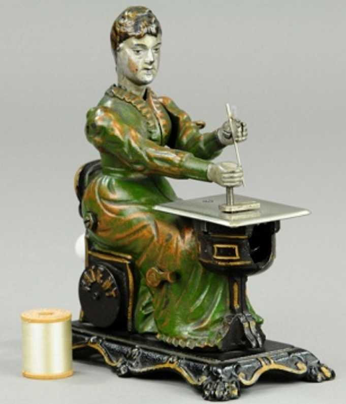 sandt cast iron toy full figure of seated woman at sewing table