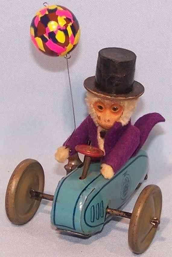 schuco 858 tin toy clockwork scooter monkey cavalier clockwork