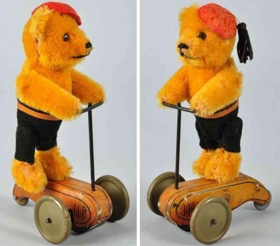 Schuco 861 Schwungradroller mit Bär