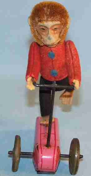 schuco 862 blech filz mohairspielzeug affe auf dreirad rosa
