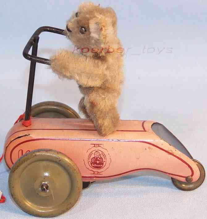 Schuco 864 Flywheel scooter with bear