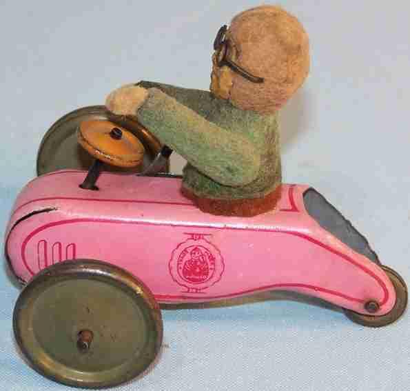 schuco 897 tin toy flywheel scooter beckoning balmy mountain felt figure