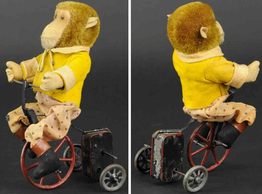 schuco tin toy monkey on tricycle clockwork