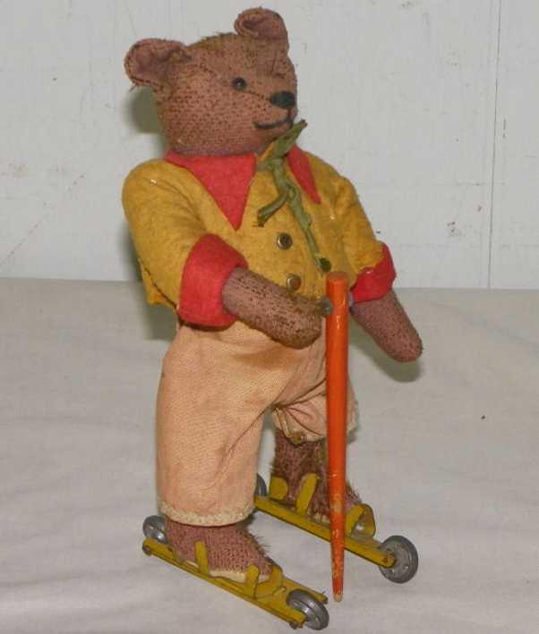 schuco blech spielzeug rolly teddybaer skiern raedern uhrwerk