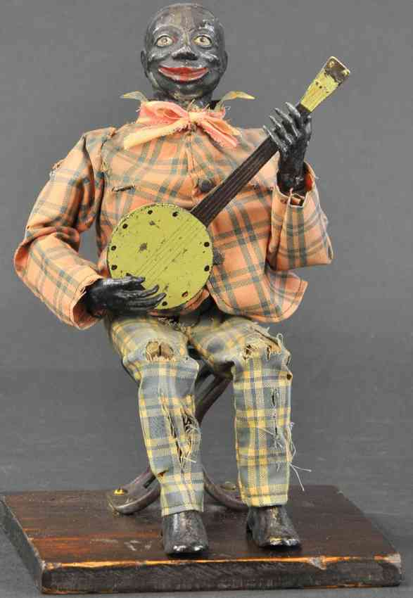secor jerome tin toy banjo player with clockwork lead