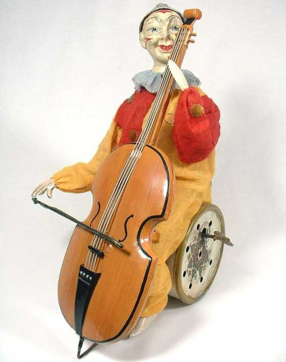 staudt leonhard 3373 tin toy clown playing bass fiddle wind-up