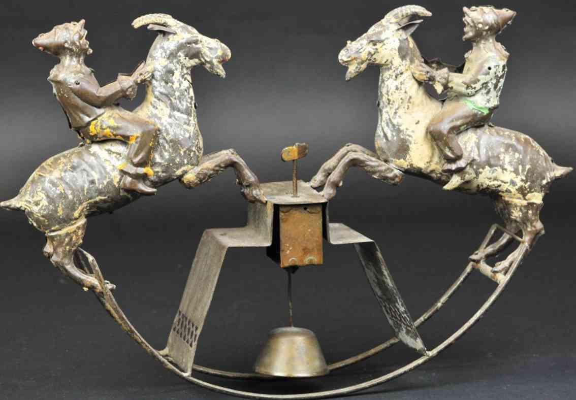 stevens co j & e tin two clowns riding goats rocking toy