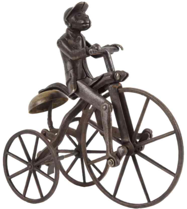 stevens co j & e cast iron toy monkey on tricycle black jacket japan diversion