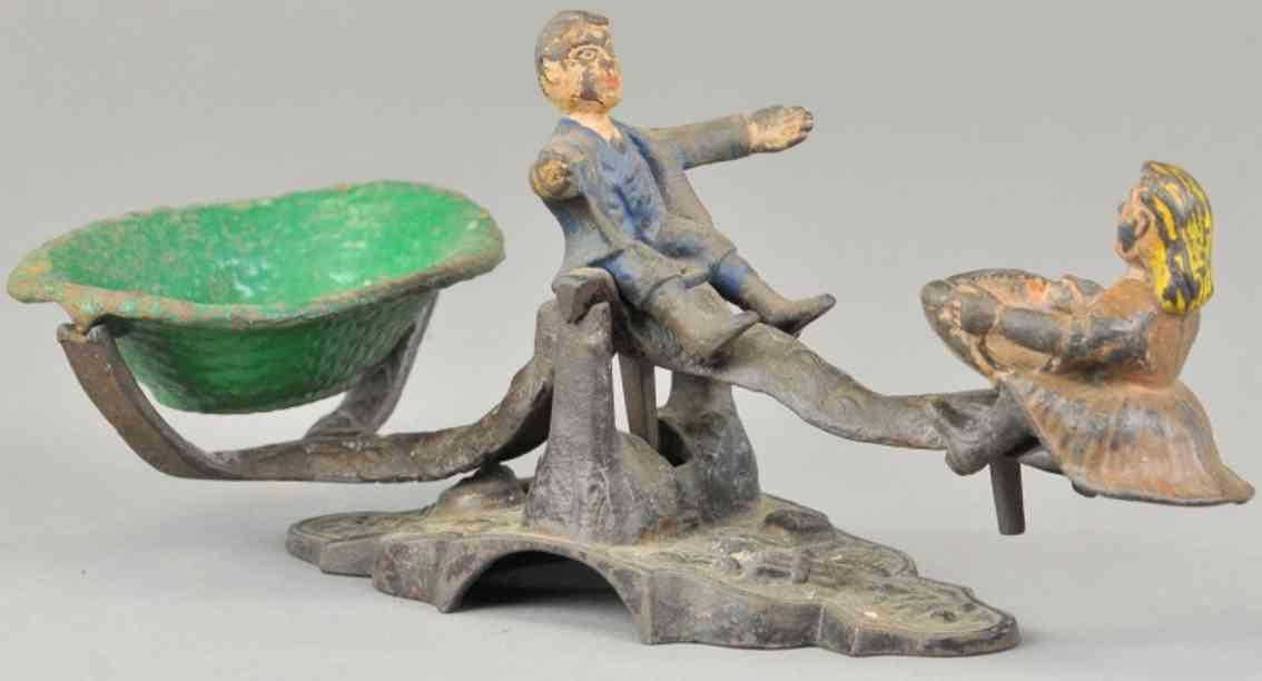stevens co j & e cast iron toy figure candy scale boy girl