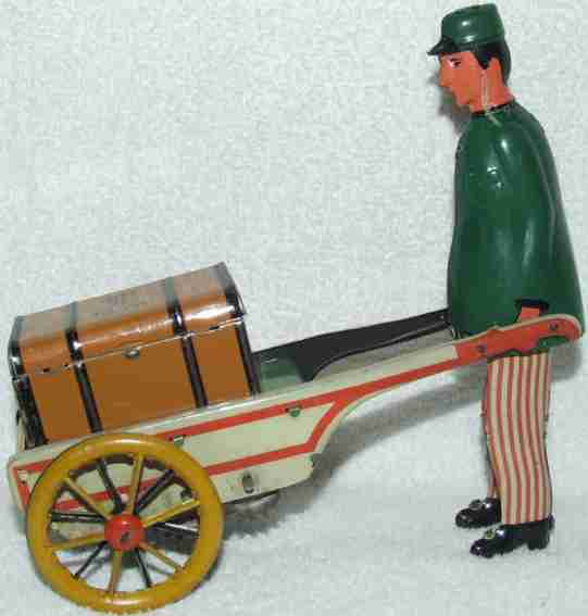 stock walter 185 tin toy baggage porter green trousers white red