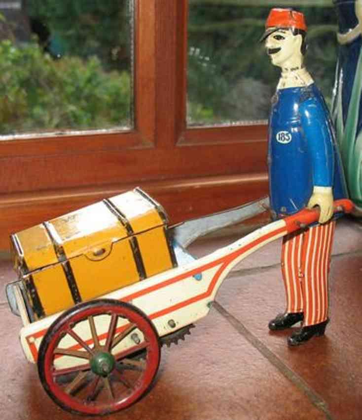 stock walter 185 tin toy baggage porter blue white braid