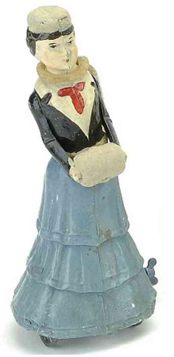 Strolling Strolling Lady with Muff painted tin clockwork