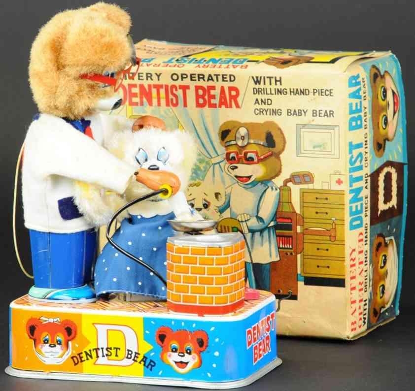 suzuki & edwards tin toy bear as dentist crying baby