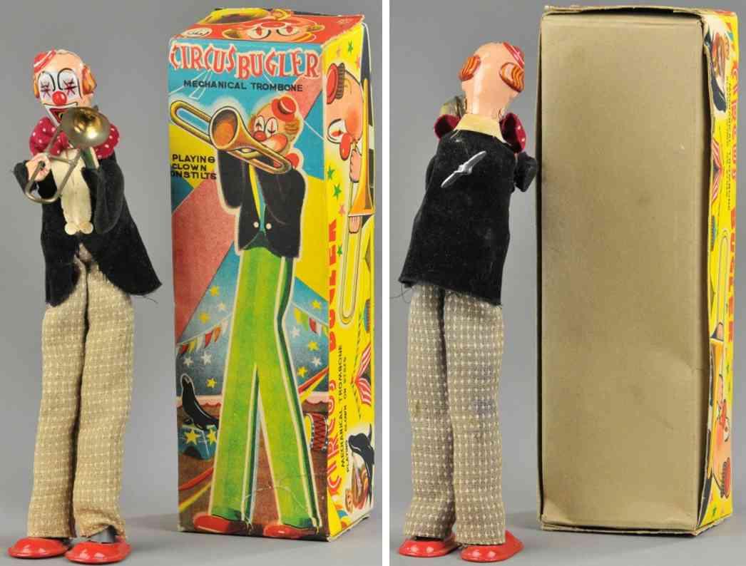 tps tin toy clown circus bugler
