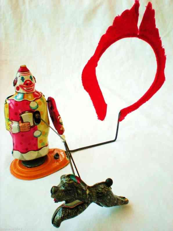 tps tin toy clown trainer and his acrobatic fire jumping dog