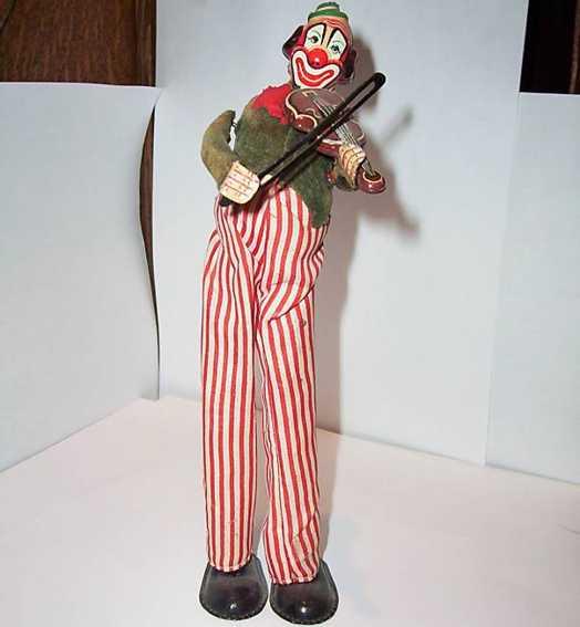 tps blech spielzeug clown mit violine auf stelzen mit uhrwerk