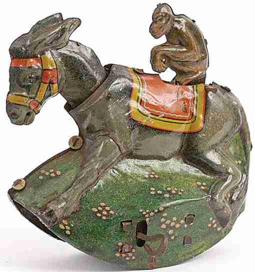 tippco tin toy monkey on donkey