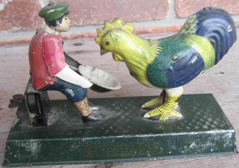 toyodo & co tin toy boy feeding chicken clockwork