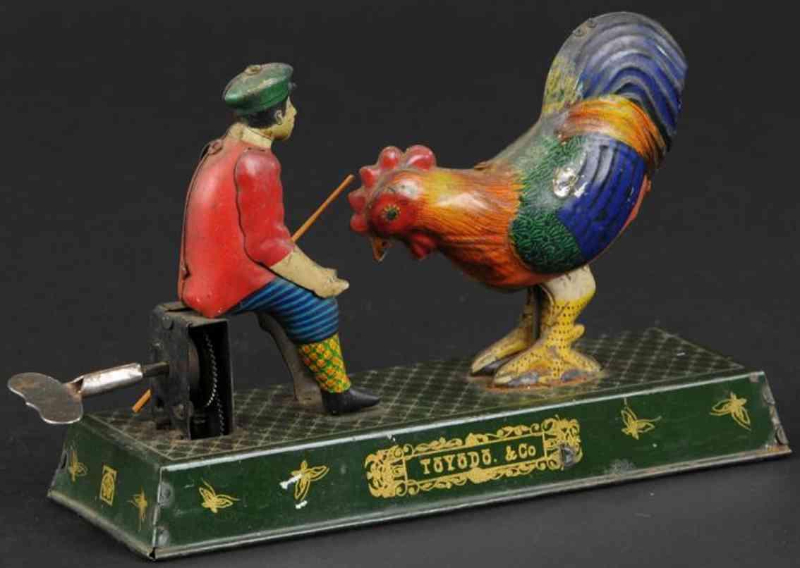 toyodo & co tin toy boy feeding rooster