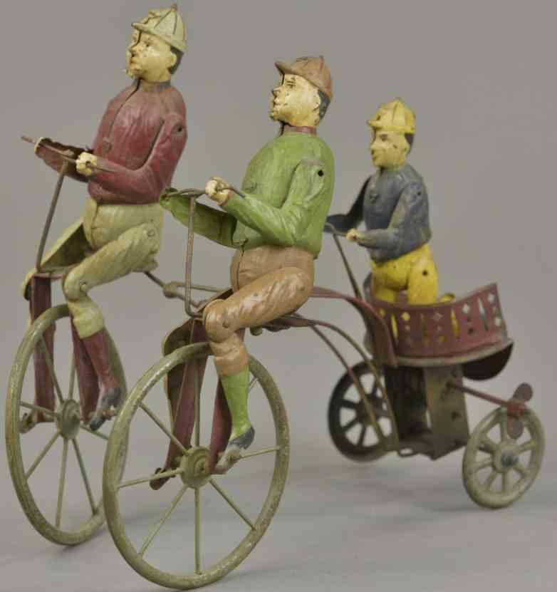 blech spielzeug drei mann auf einem fahrrad uhrwerk