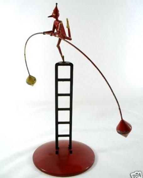 tin toy clown balancing