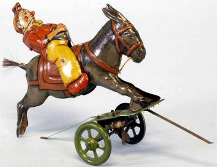tin toy clown on donkey clockwork