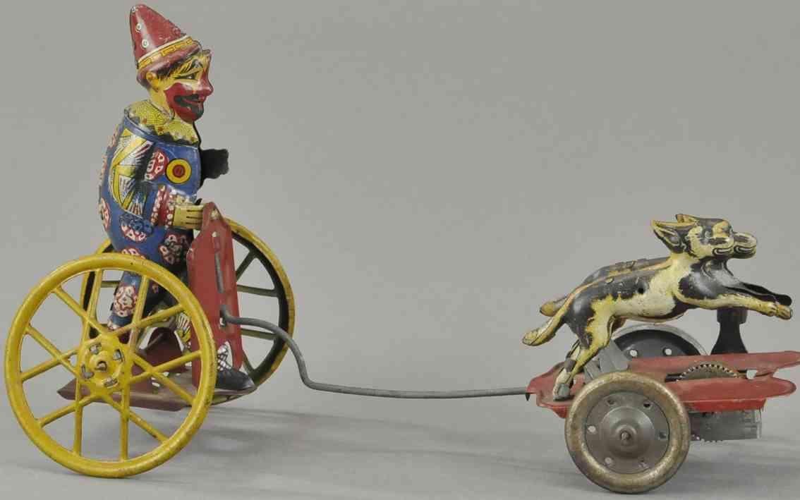 blech spielzeug clown clown auf karre gezogen von zwei hunden auf plattform