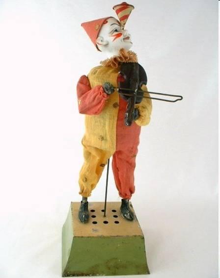 Clown mit Porzellankopf und Violine