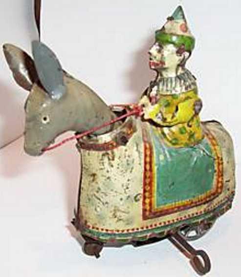 Clown auf einem Esel mit Uhrwerk