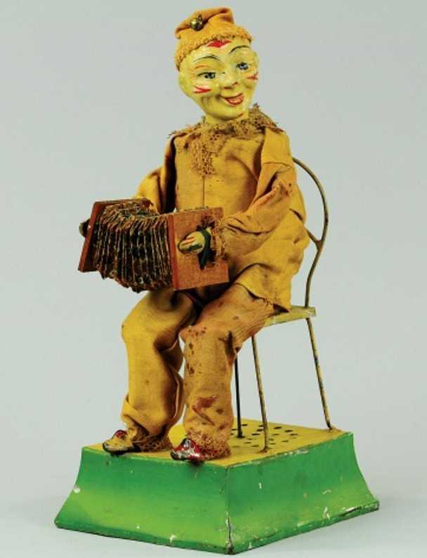 Clown auf Stuhl und Zieharmonika