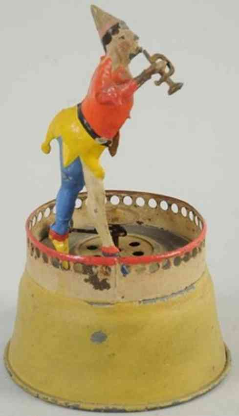 tin wind-up toy clown with horn