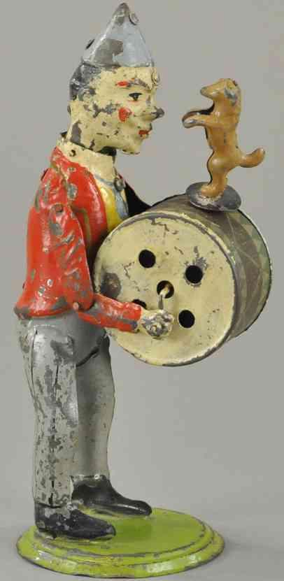blech spielzeug clown als musiker mit trommel und pudel