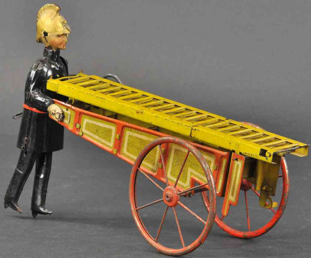 tin wind-up toy german fireman with ladder cart