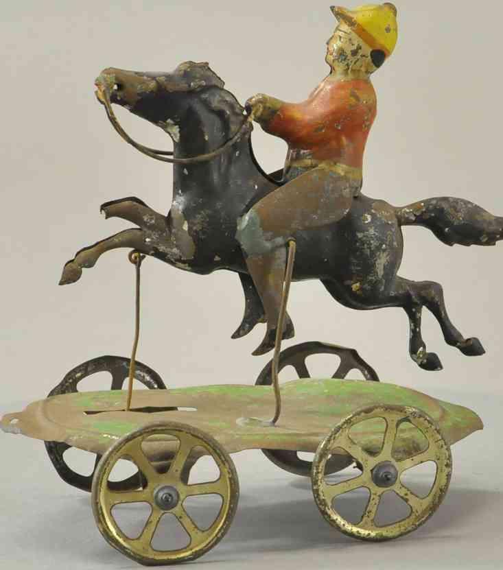 blech spielzeug jockey mit pferd auf plattform