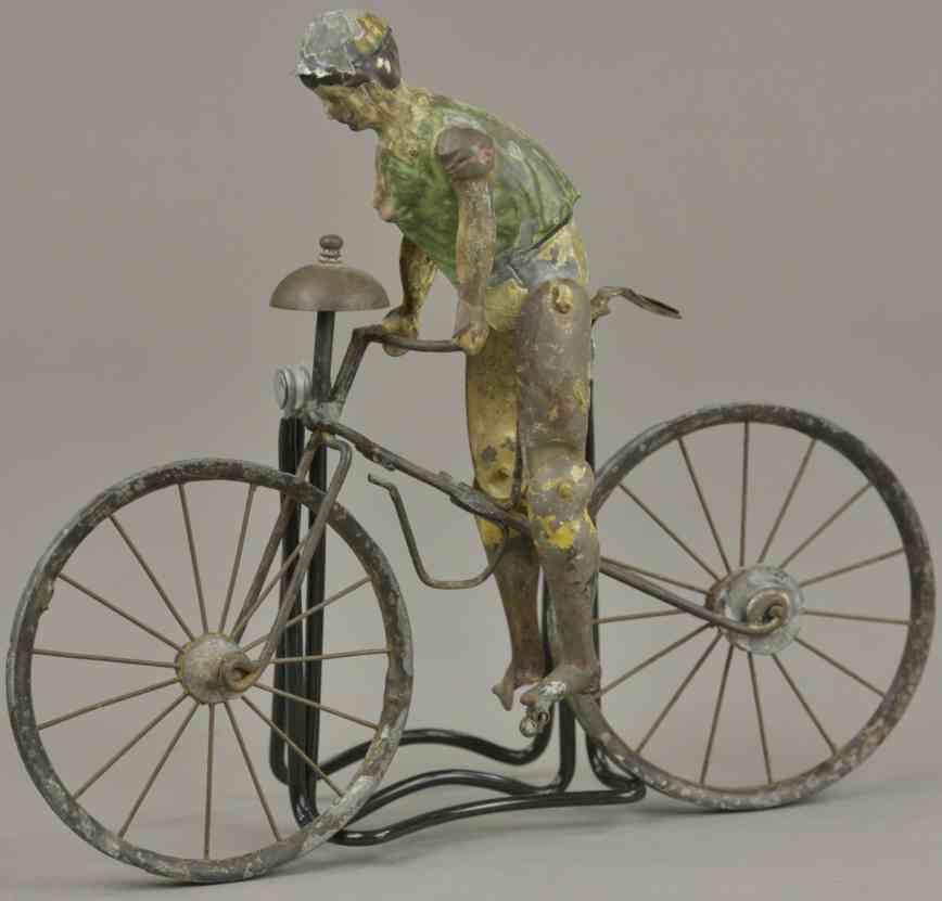 blech spielzeug junge auf fahrrad