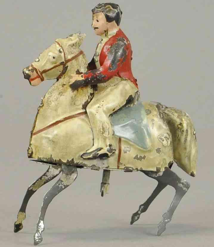 blech spielzeug junge auf tänzelndem pferd uhrwerk