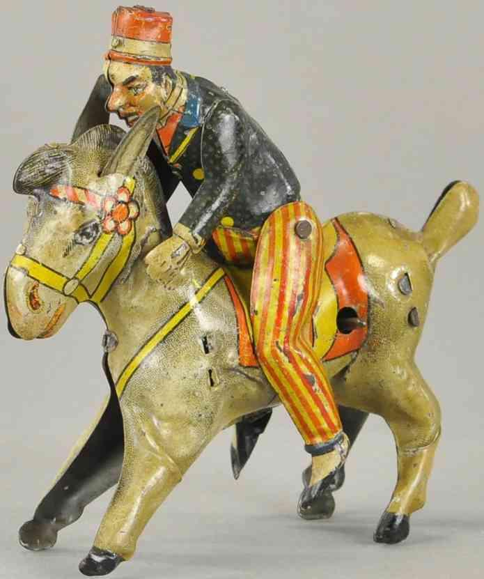 blech spielzeug mann reitet auf einem esel
