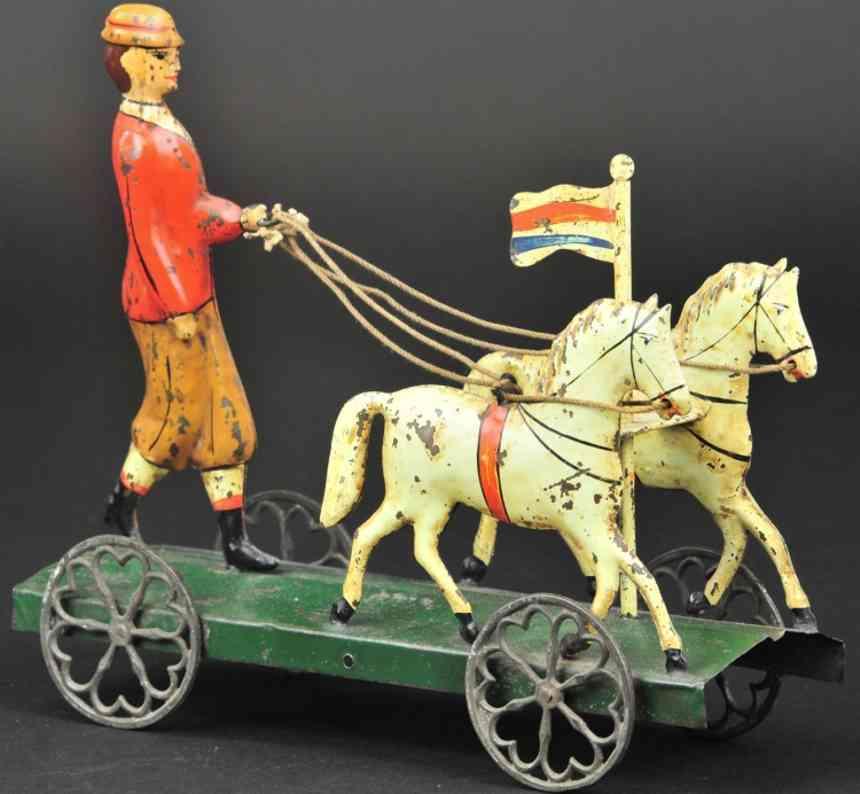 blech spielzeug suffragette auf gruener plattform zwei pferd