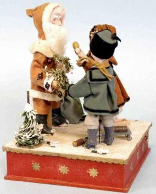 Weihnachtsmann mit Junge und Mädchen