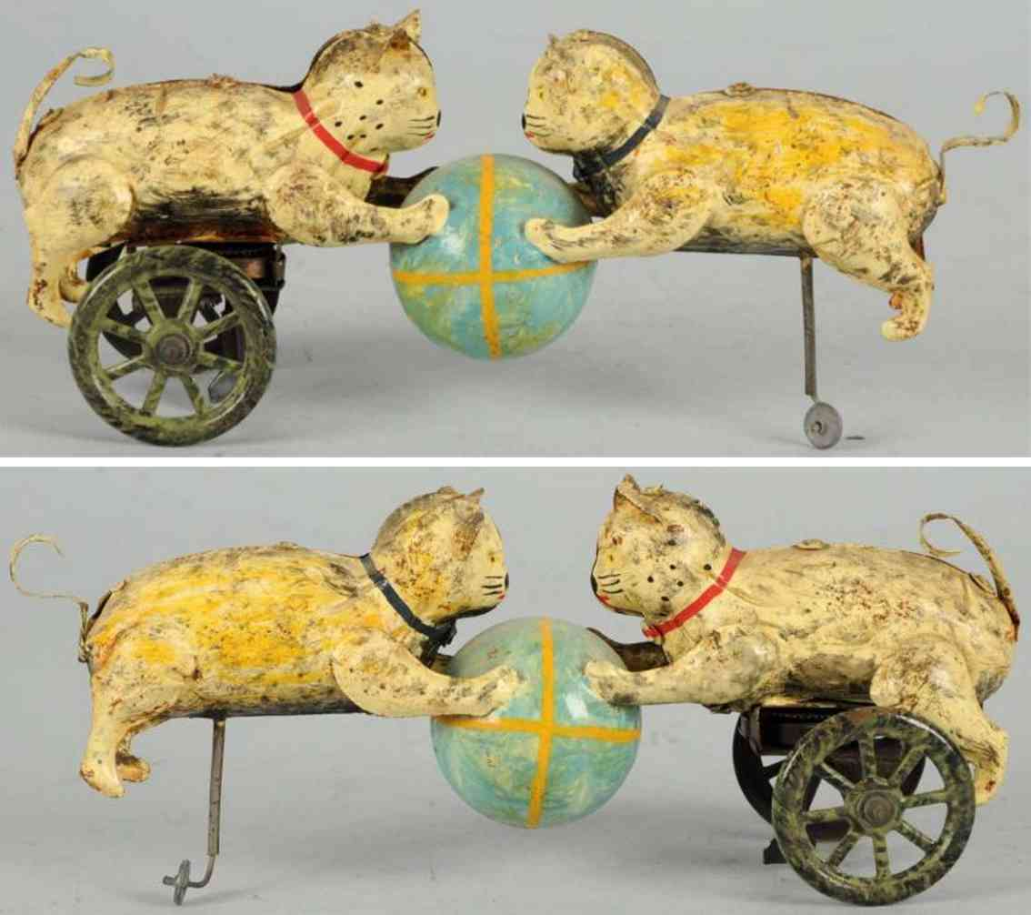 tin toy cats and ball