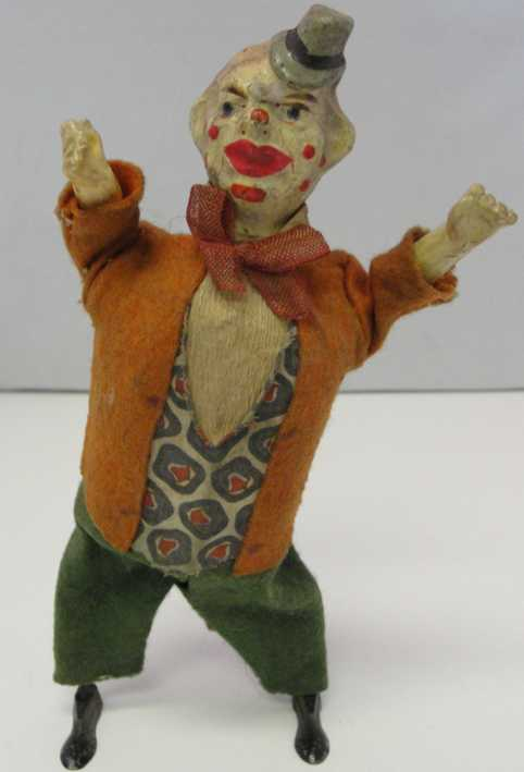 tin toy clown wind-up toy