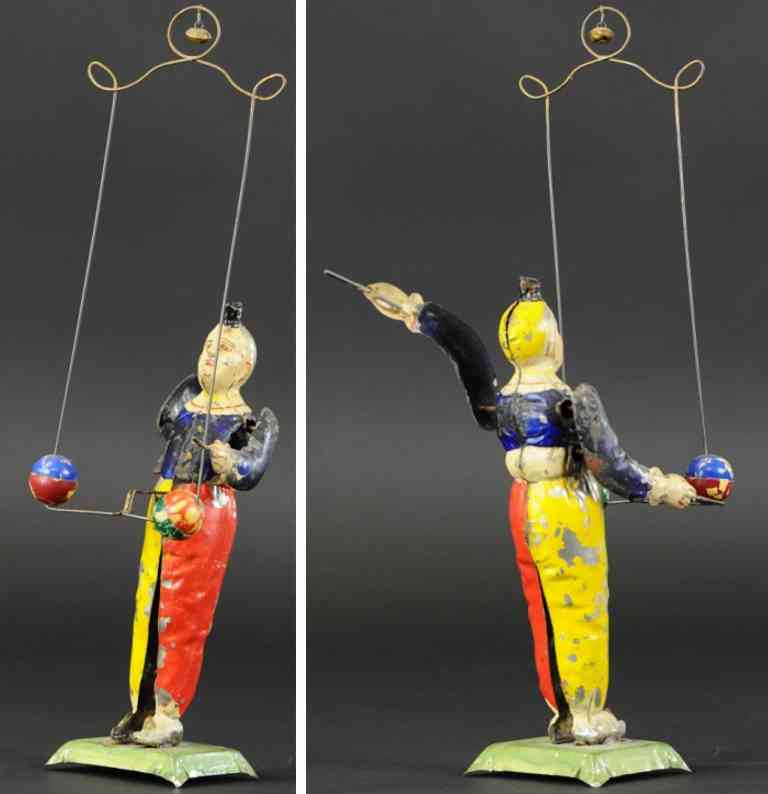 tin toy clown juggling balls